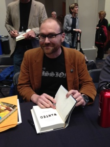 "Chris Hoke signing my copy of ""WANTED."""